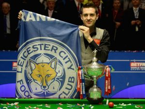 SHEFFIELD, ENGLAND - MAY 02: Mark Selby with a Leicester City football club flag after lifting the trophy after beating Ding Junhui to win the World Snooker Championship final at the Crucible Theatre on May 02, 2016 in Sheffield, England. (Photo by Gareth Copley/Getty Images)